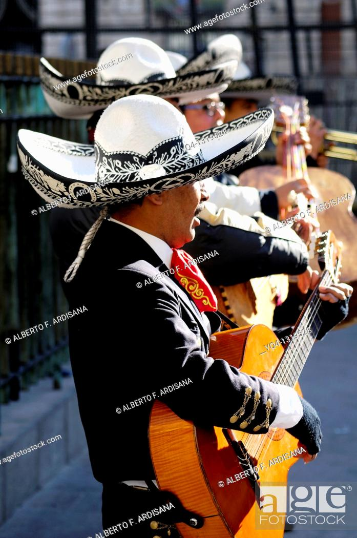 Stock Photo: Mariachis playing in the Puerta del Sol, Madrid, Spain.
