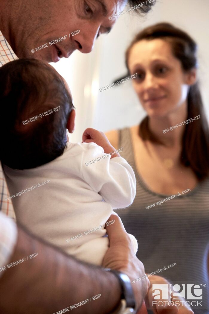 Stock Photo: Reportage on a midwife in Lyon, France. A 7-day old baby.