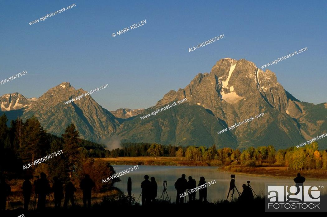 Stock Photo: People photographing mountains Grand Teton National Park Wyoming USA.