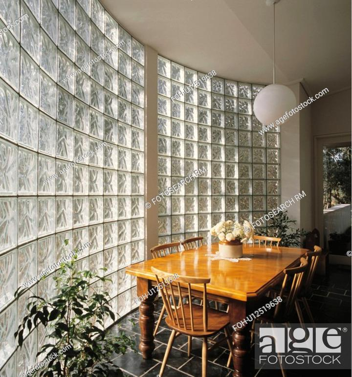 50 Bold And Inventive Dining Rooms With Brick Walls: Wooden Table And Chairs In Eighties Dining Room With