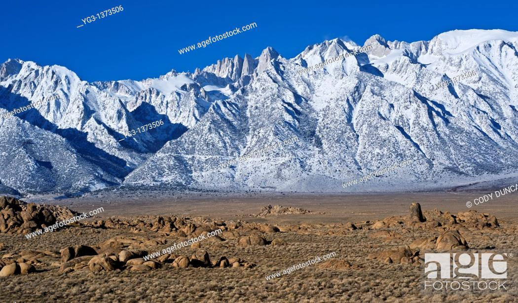Stock Photo: Granite rock formations of Alabama Hills with Mount Whitney and Sierra Nevada mountains in background, California.