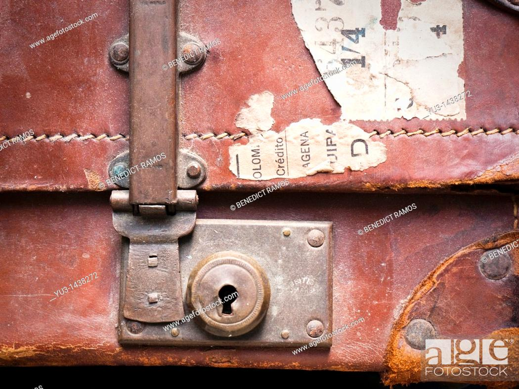 Stock Photo: Detail of old brown leather suitcase with torn labels.
