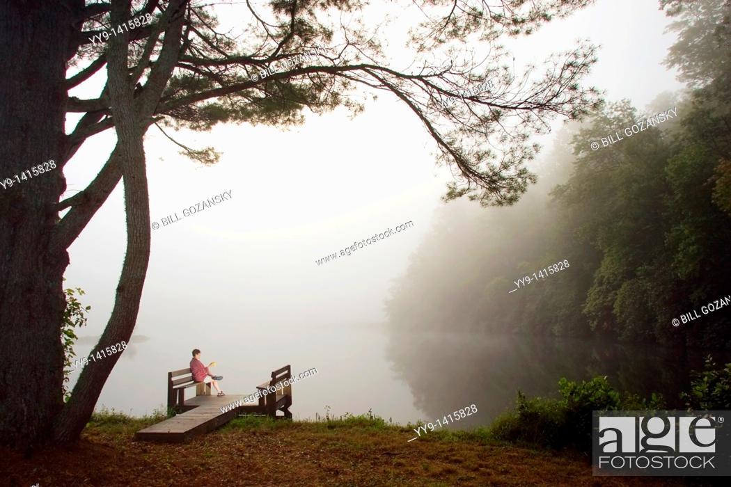 Stock Photo: Woman having morning coffee on dock - Brevard, North Carolina.