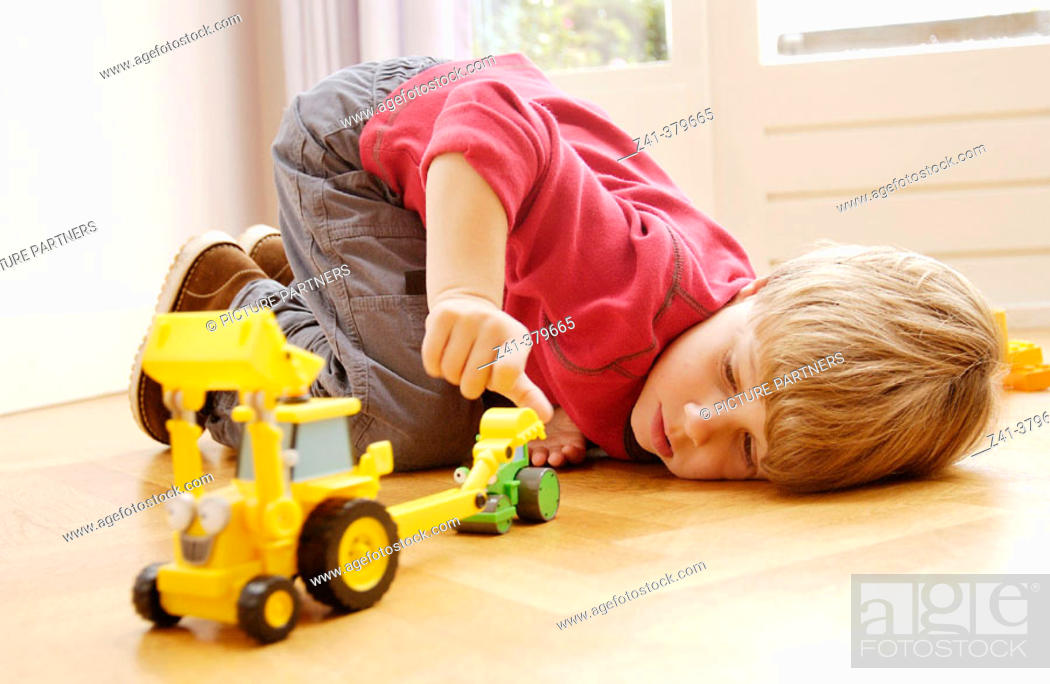 Stock Photo: Little boy playing at the floor.