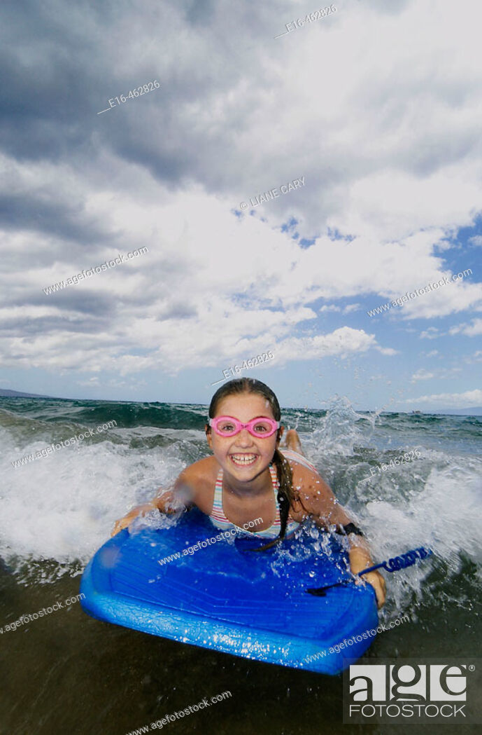 Stock Photo: Happy girl boogie boarder.