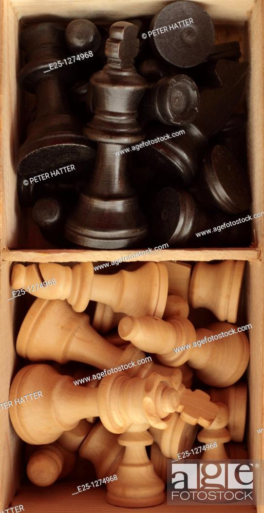 Stock Photo: Black and white chess pieces in a compartmentalised box.