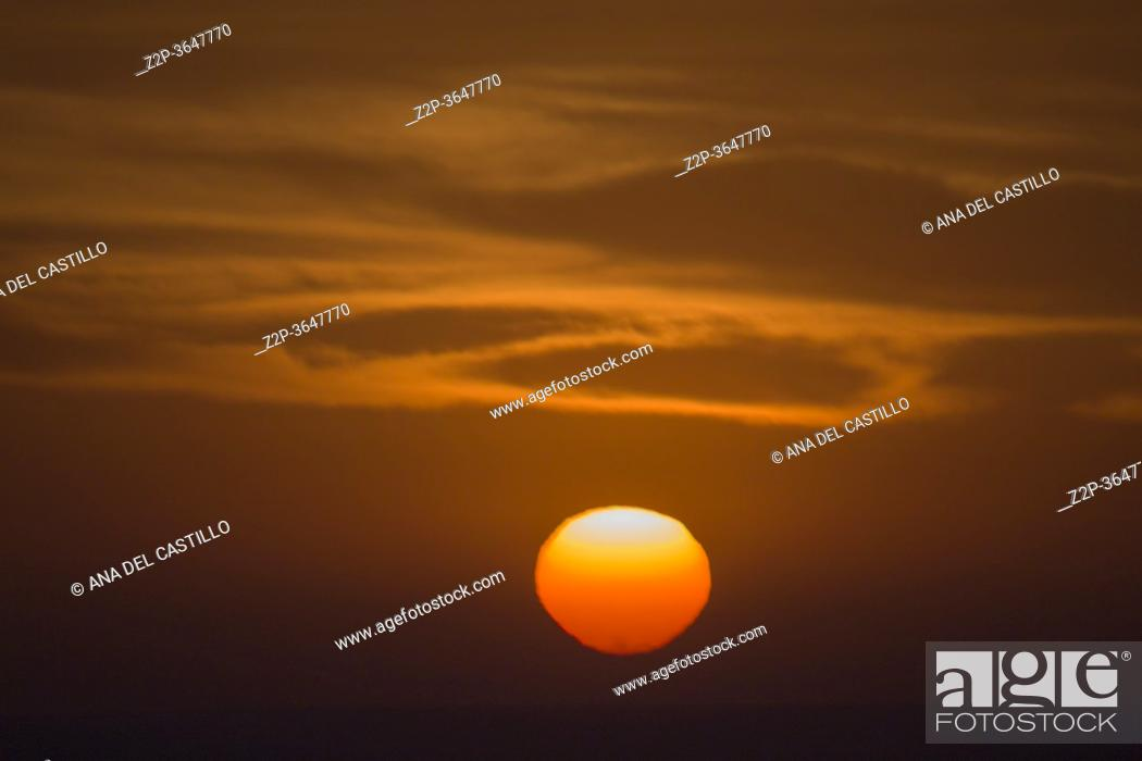 Stock Photo: Beautiful sunrise over the Mediterranean Sea from Cullera beach at lighthouse.