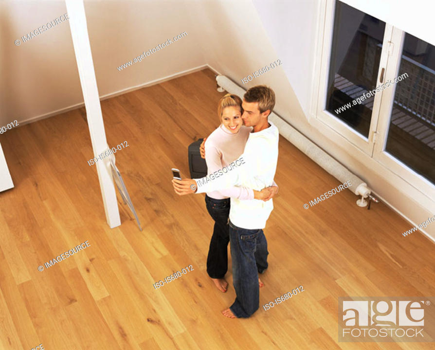 Stock Photo: Couple in their new home.