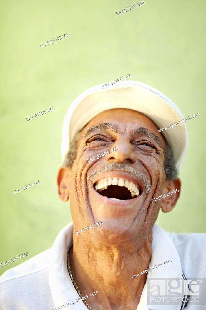 Stock Photo: aged latino man smiling for joy.