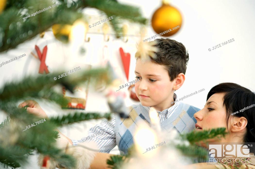 Stock Photo: Mother and young son decorating Christmas tree.