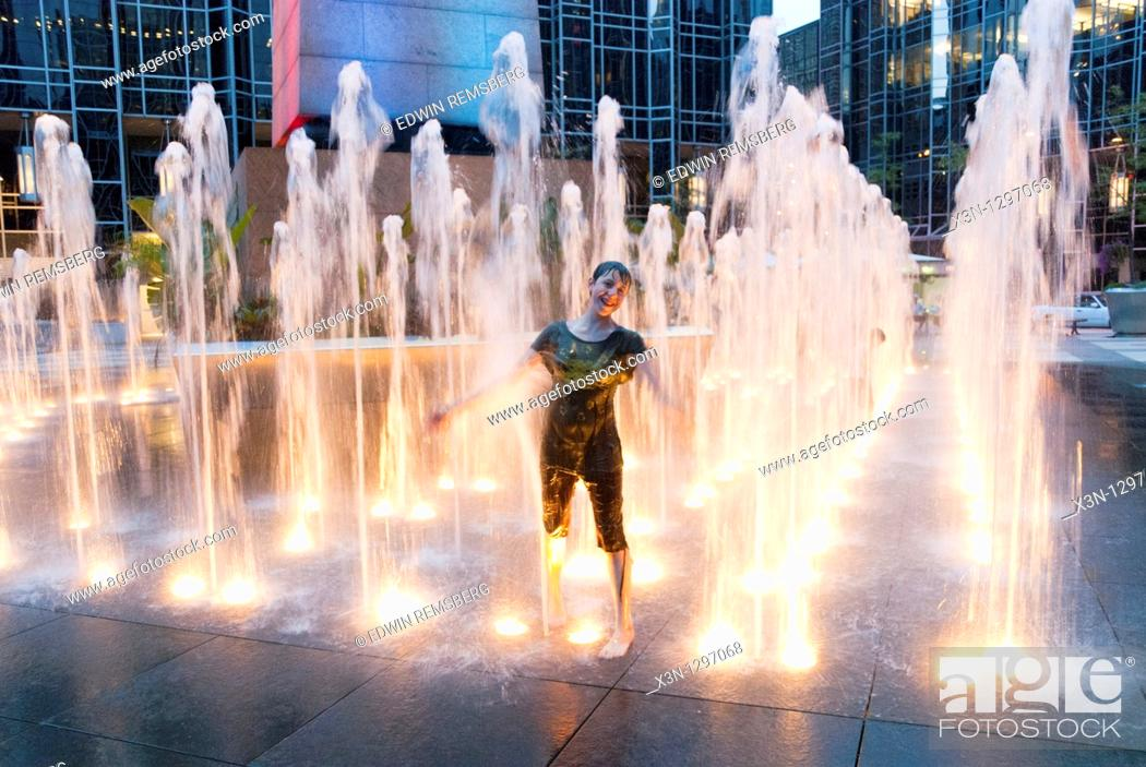 Stock Photo: Girl in fountain, PPG Plaza in Pittsburgh.