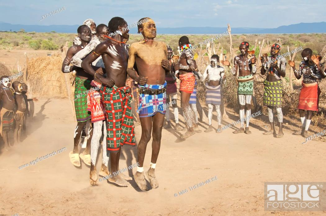 Stock Photo: Karo people with body paintings participating in a tribal dance ceremony, Omo river Valley, Southern Ethiopia.