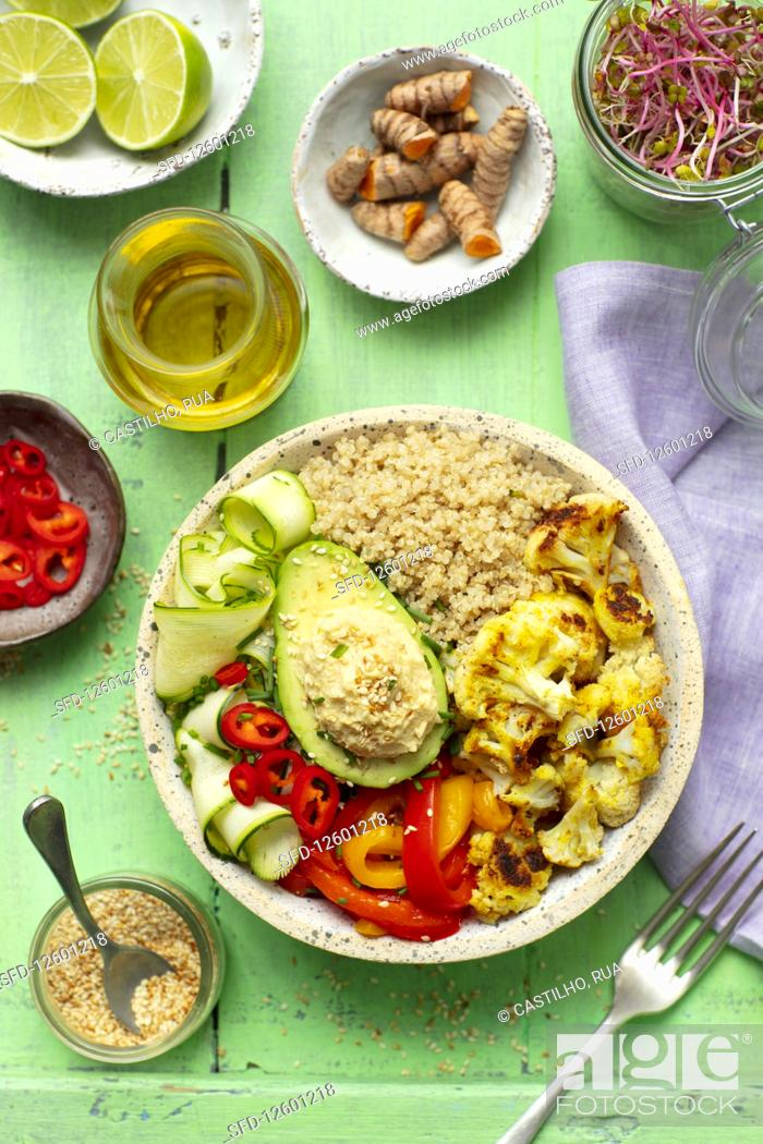 Stock Photo: Buddha bowl (vegan) with quinoa, avo, hummus, baked cauliflower and pepper.