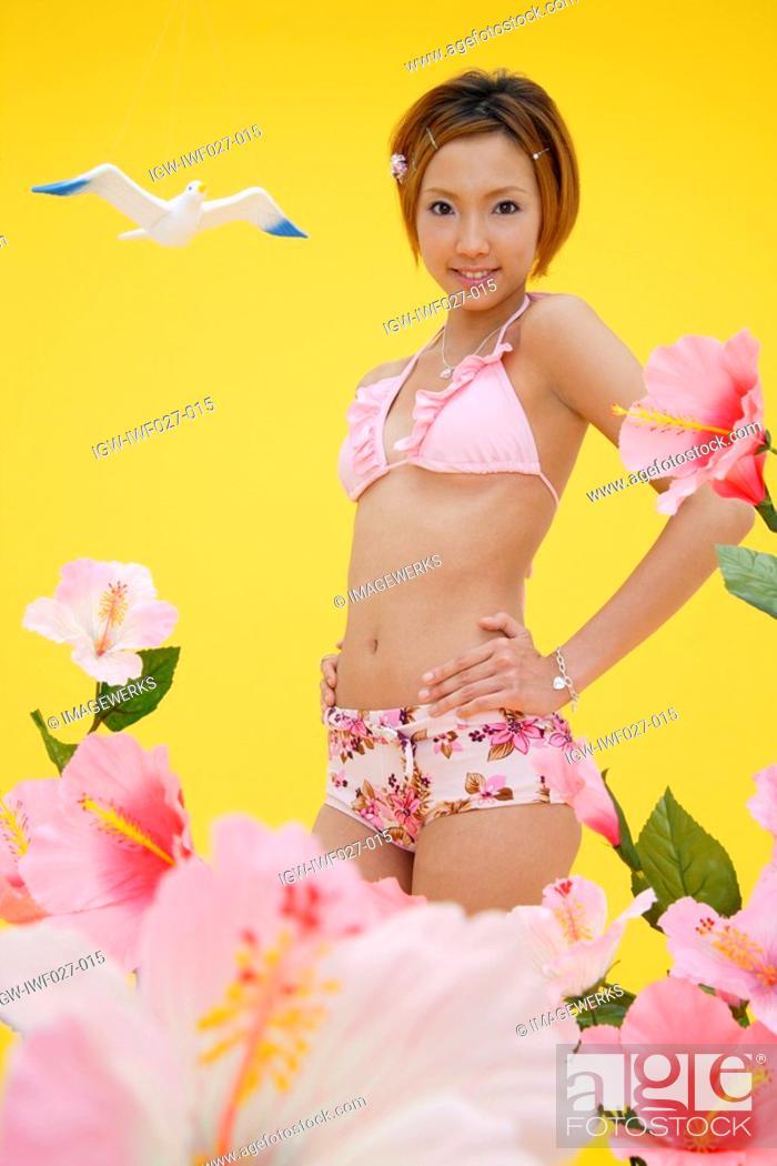 Stock Photo: Portrait of a teenage girl in bikini.