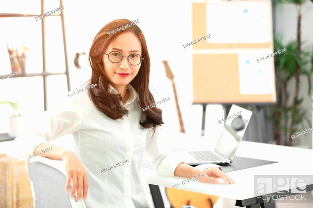 Stock Photo: Asian woman using laptop, workplace at home. Concept of Asian woman lifestyle.