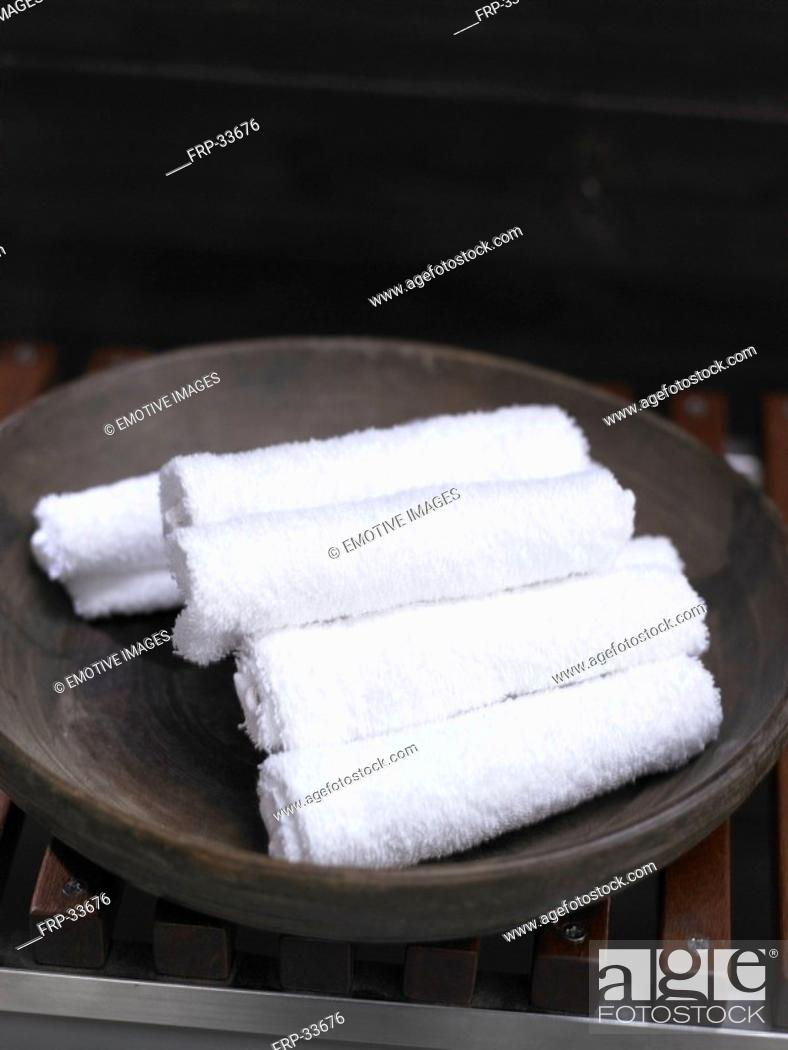Stock Photo: White towels in a black dish.