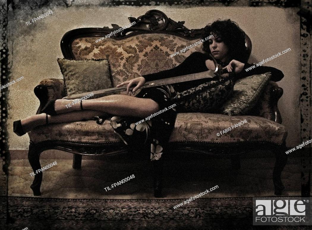 Swell A Young Woman Resting On An Ornate Sofa Stock Photo Gmtry Best Dining Table And Chair Ideas Images Gmtryco