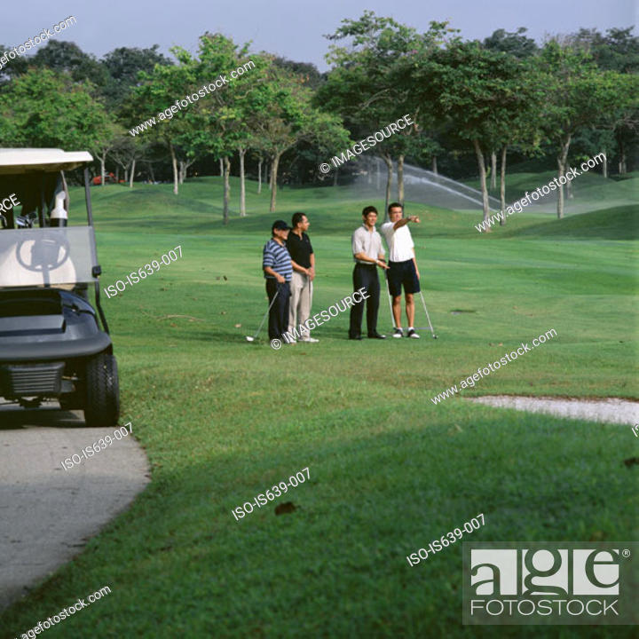 Stock Photo: Four men playing golf.