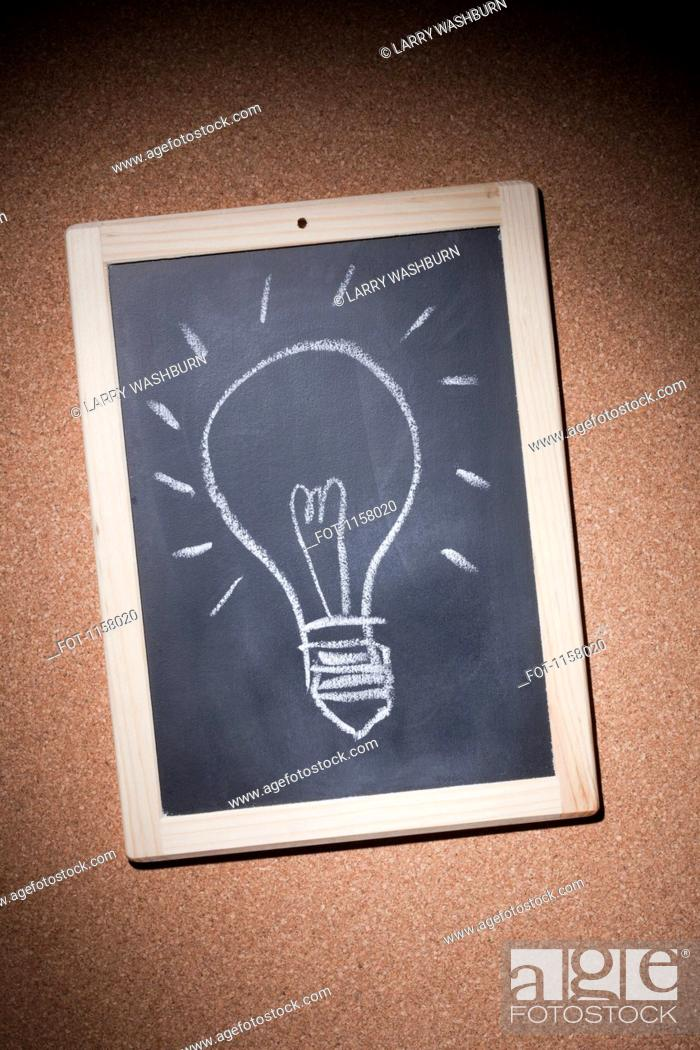 Stock Photo: An illuminated light bulb drawn in chalk on a small chalkboard.