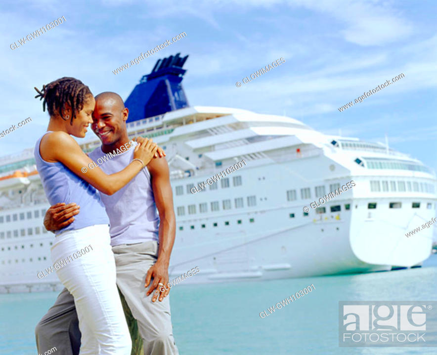 Stock Photo: Close-up of a young couple embracing each other in front of a cruise ship, Bermuda.