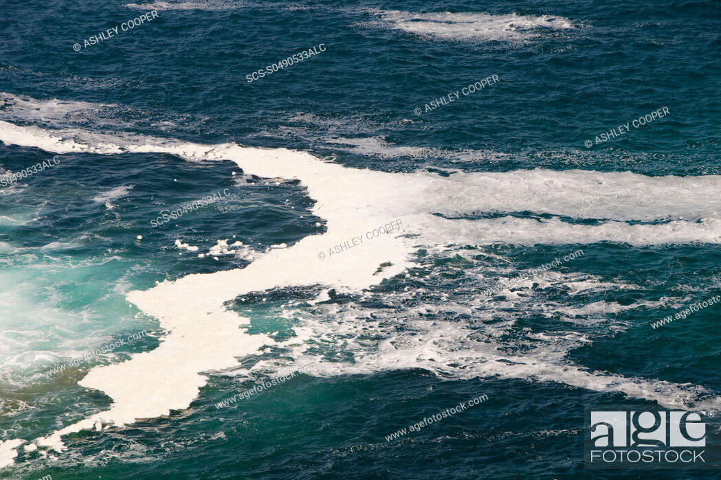 Stock Photo: Spume on the coast near St Just, Cornwall, UK.