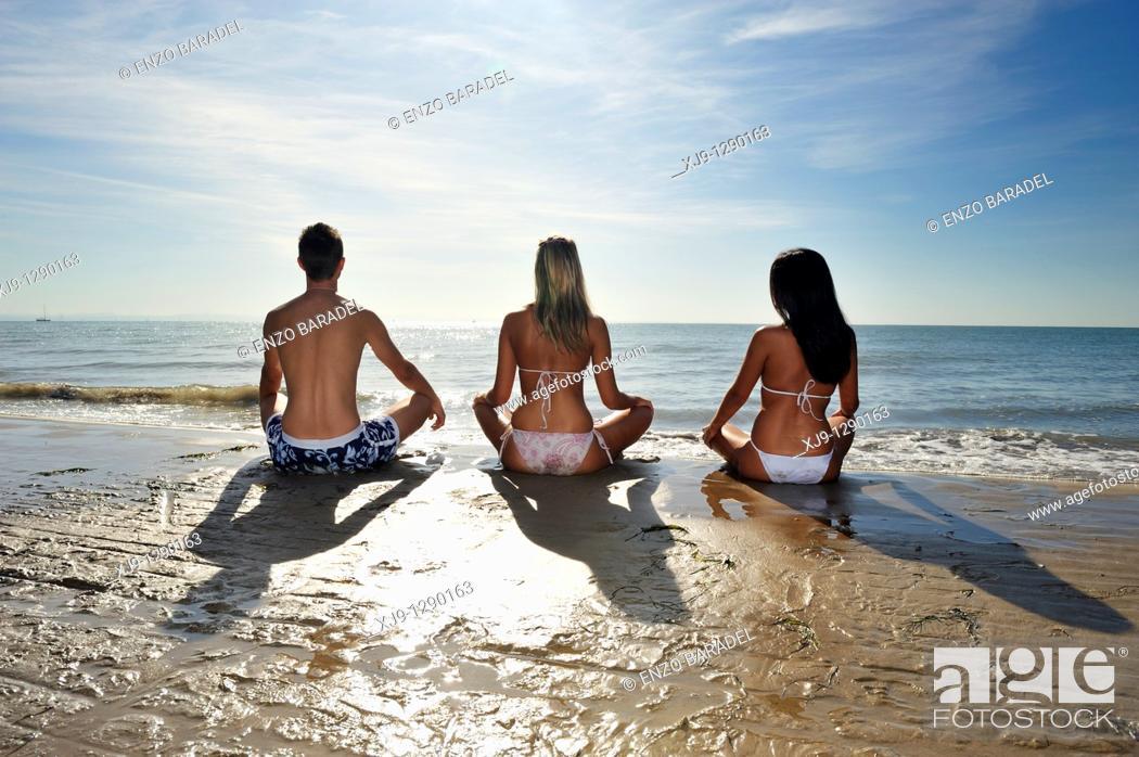 Stock Photo: Yoga at sunrise.