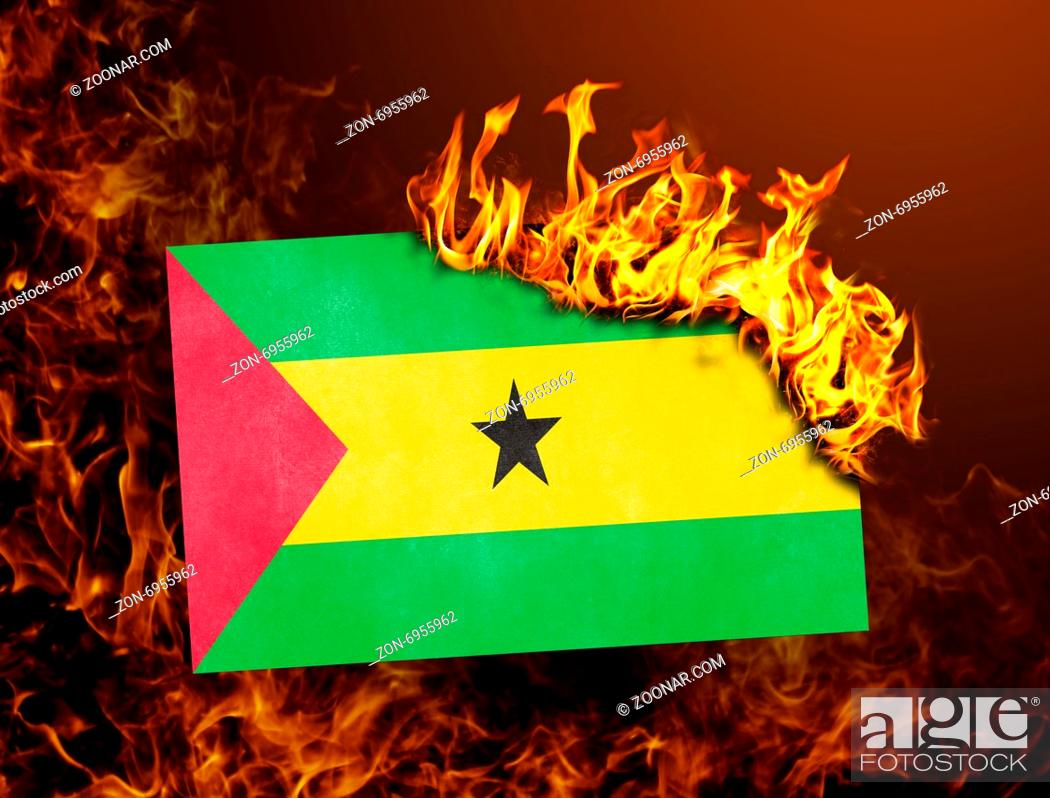 Imagen: Flag burning - concept of war or crisis - Sao Tome and Principe.