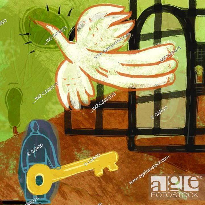 Stock Photo: A man holding a key, freeing a large bird from a cage.