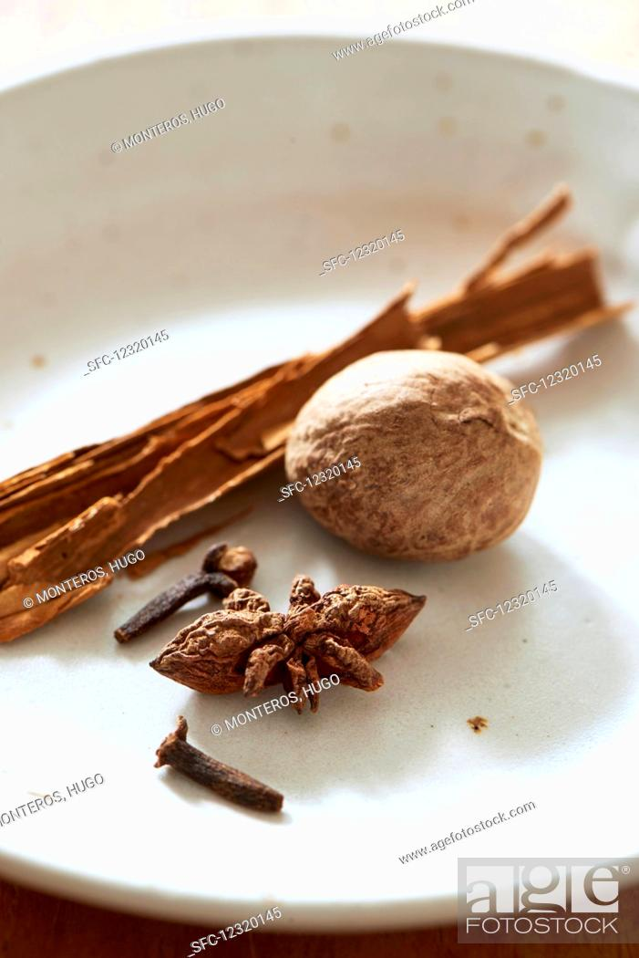 Stock Photo: Nutmeg, star anise, cloves and a cinnamon stick.