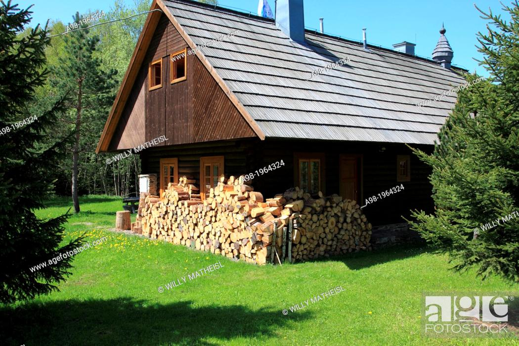 Stock Photo: stack of firewood at the facade of an old historic building in the village Prasily, Bohemian Forest, Sumava National Park, Czech Republic, Europe.