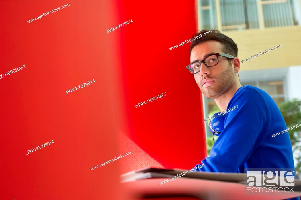 Stock Photo: Man sitting in an office.