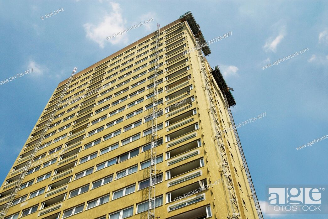 Stock Photo: Insulation layers added to 1960s tower block as part of a refurbishment programme, Bow, East London, UK.