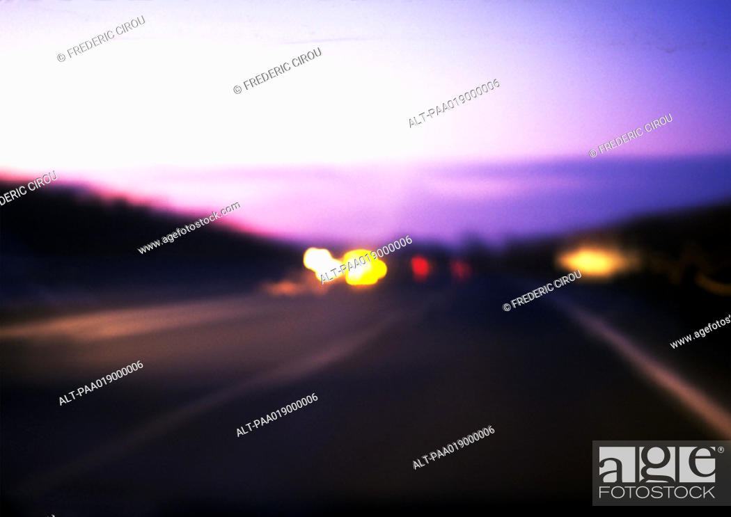 Stock Photo: Road at night with cars, blurry.