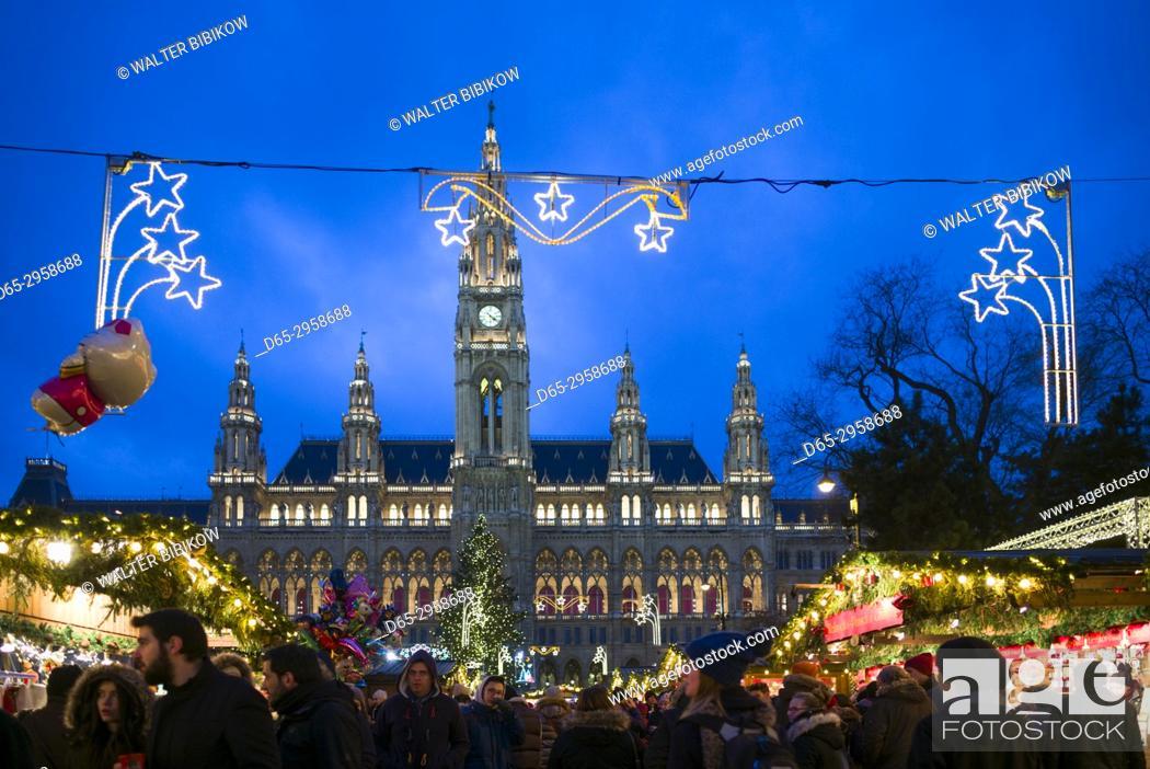 Stock Photo: Austria, Vienna, Rathausplatz Christmas Market by Town Hall, evening.