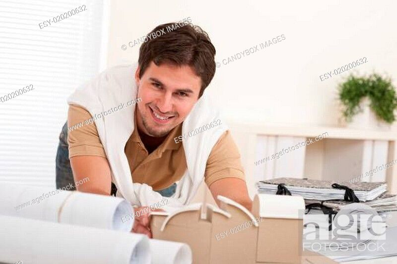 Stock Photo: Successful architect man working at office.