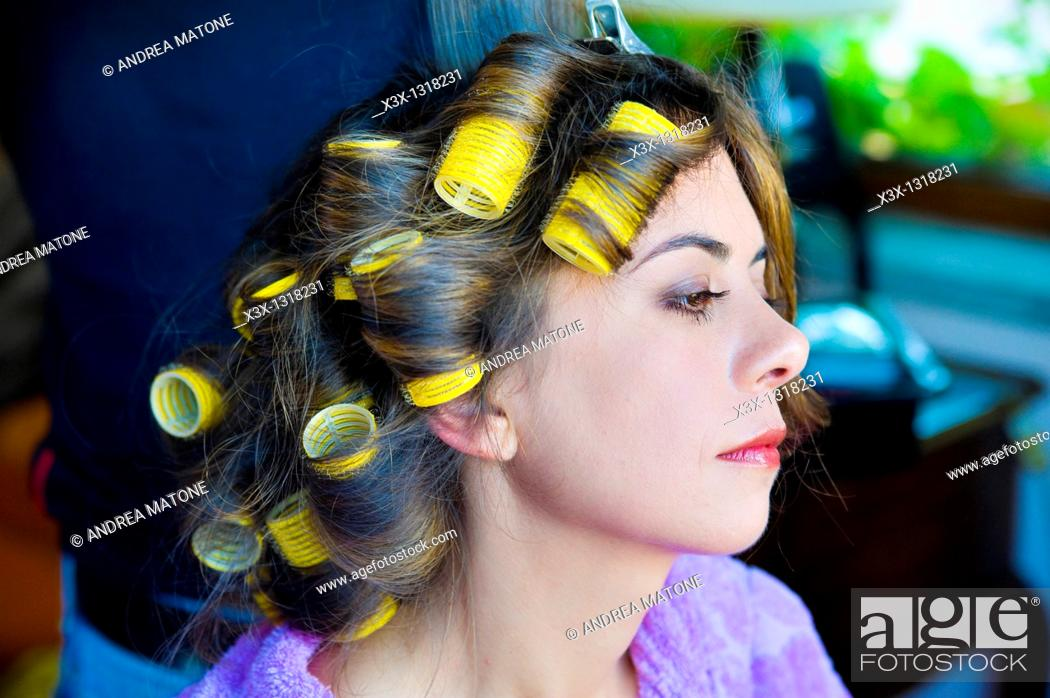 Stock Photo: Woman's hair on curlers.