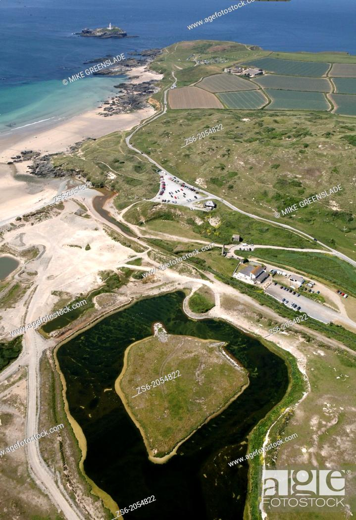 Stock Photo: Aerial of Godreavy Lighthouse and the Red River Nature Reserve, Cornwall, UK.