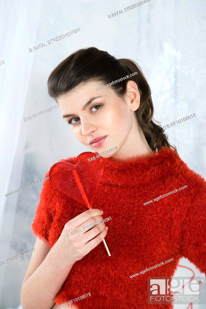 Stock Photo: Woman with heart shaped lollipop.