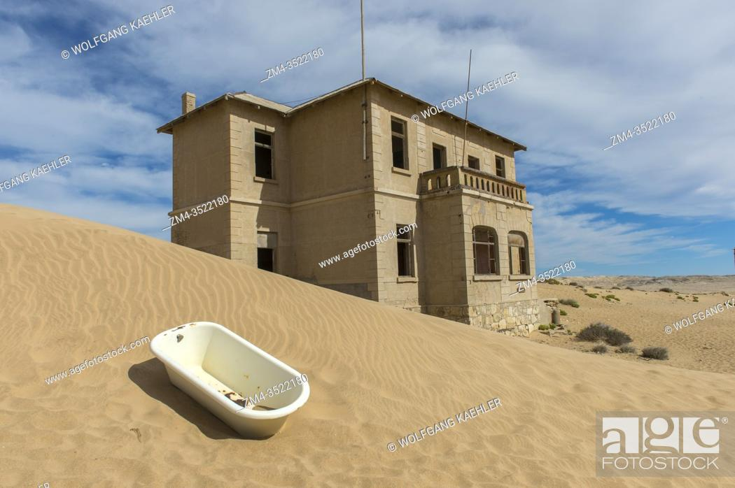 Stock Photo: Bathtub in the sand in front of a building in the abandoned (1954) German diamond mining settlement of Kolmanskop near Luderitz, Namibia.