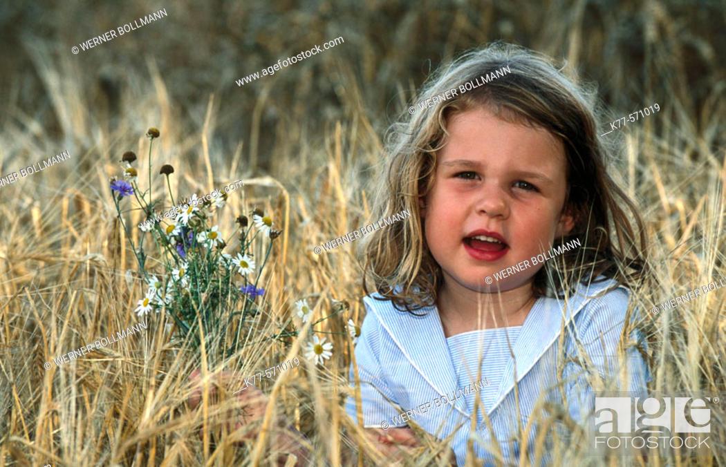 Stock Photo: Little girl in grain field. Bornholm. Denmark.