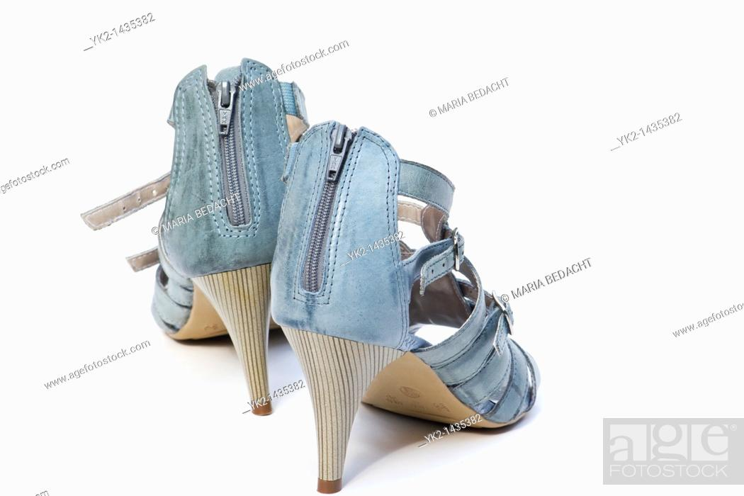 Stock Photo: Closeup of high heeled shoes on white background.