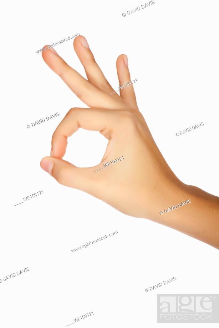 Stock Photo: Caucasian female using hand gestures to say ok.