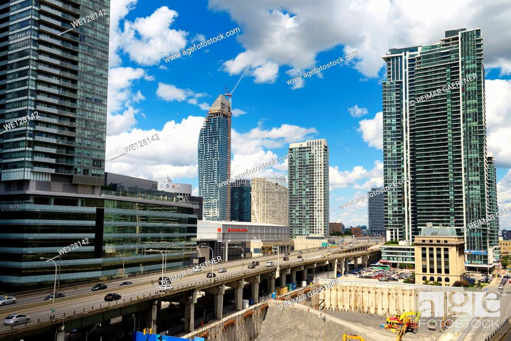 Stock Photo: New construction along the Gardiner Expressway Toronto including the L Tower and Air Canada Centre.