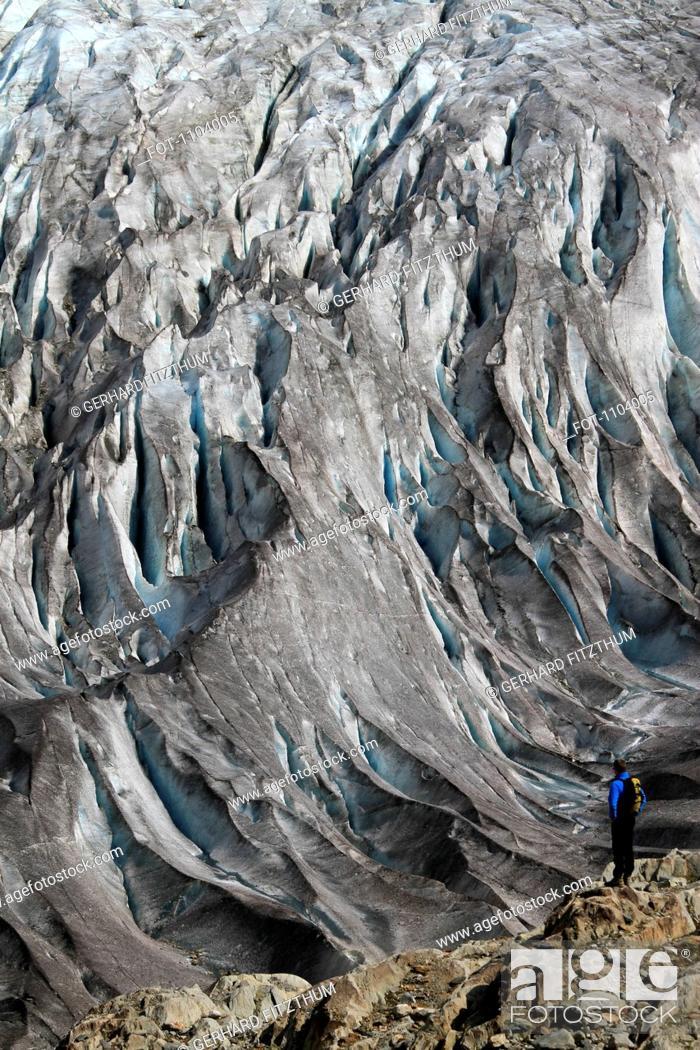 Stock Photo: A man looking at the Aletsch Glacier, Valais Canton, Switzerland.