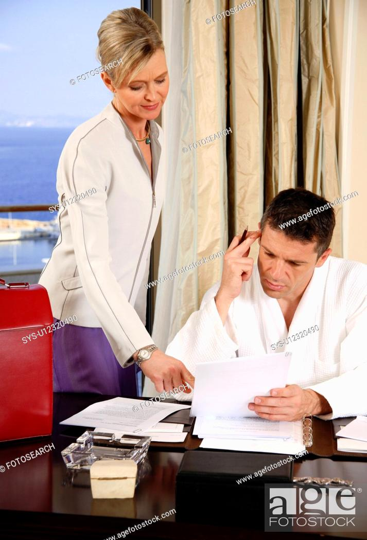Stock Photo: Two business people working in a hotel room.