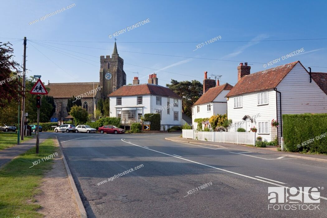 Stock Photo: England Kent Rolvenden High Street with St  Mary the Virgin Church.