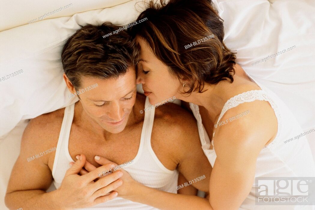 Stock Photo: Couple hugging in bed.