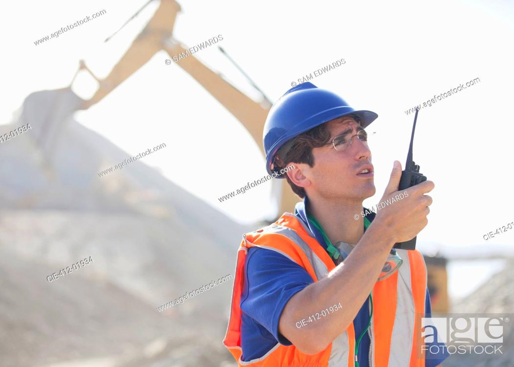 Stock Photo: Worker using walkie-talkie in quarry.