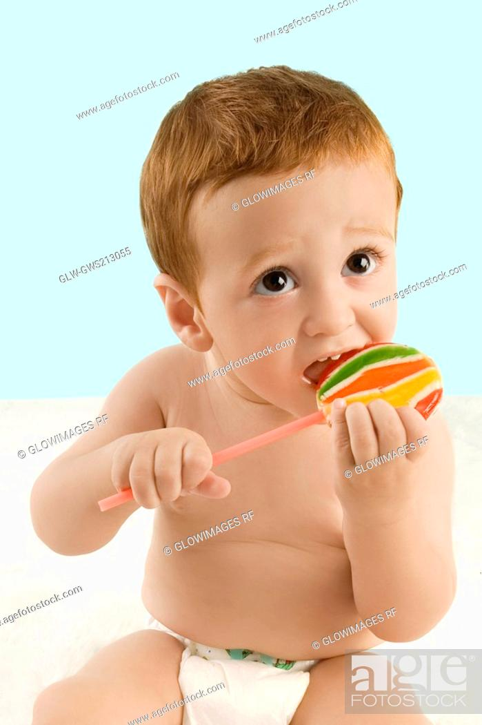 Stock Photo: Close-up of a boy licking a lollipop.