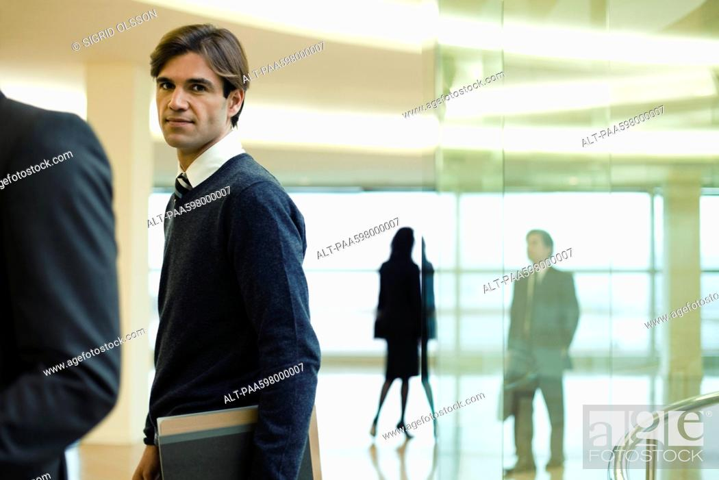 Stock Photo: Businessman in lobby, portrait.